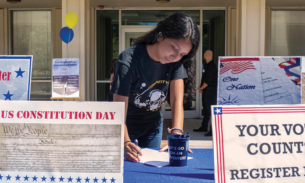 Student filling out voter registration.