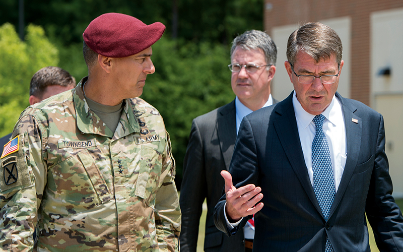 Secretary of Defense Ash Carter speaks with Army Lt. Gen. Stephen Townsend, left, XVIII Airborne Corps commanding general, during a visit to Fort Bragg, N.C., July 27, 2016.