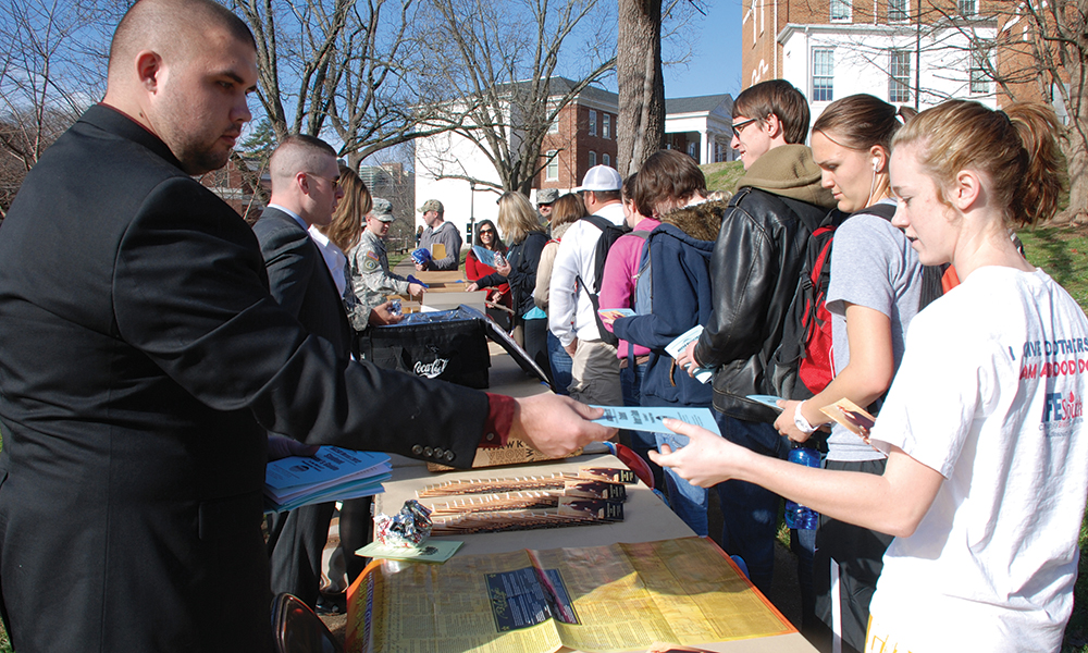 Students picking up a voter guide.