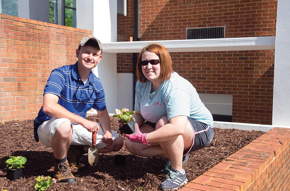 Alumni Weekend - alumni helping with beautification of campus.
