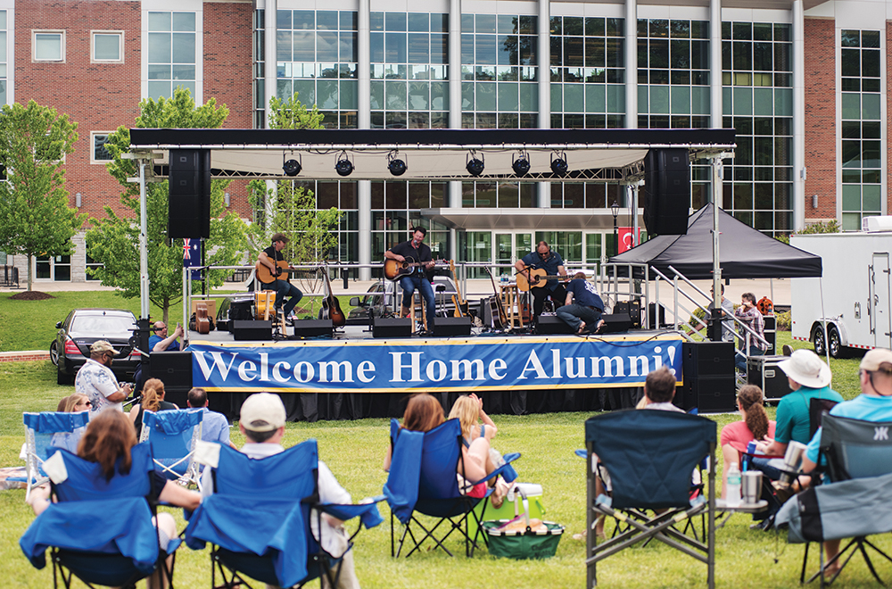 Alumni Weekend - attendees listen to local and alumni talent.