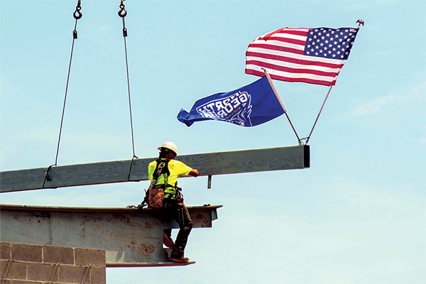 Final beam for convocation center being lowered in place.
