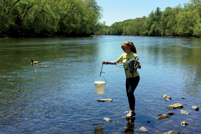 UNG student Alaina Bailey takes a water sample at Buford Dam.