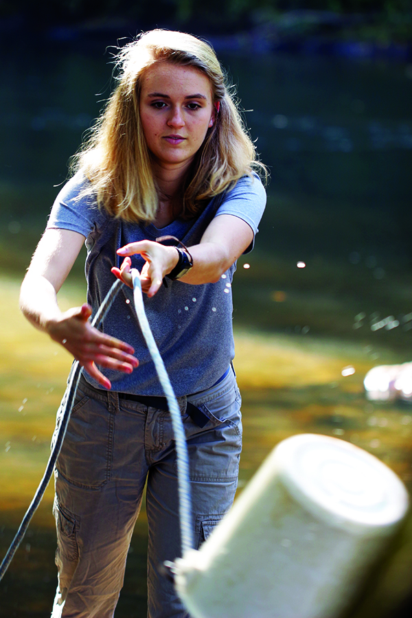 UNG student Arianna Disser collects water samples from the Chestatee River.