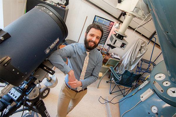 Dr. Gregory Felden with his telescope