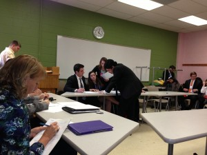 Students prepare for their semifinal round against Duke University.