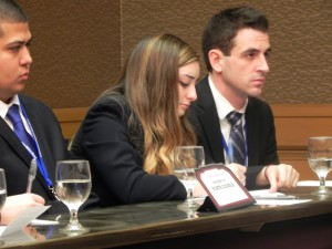 (left to right) Team members Efron Chavez, Keely Jabloner, and Robert Johnson prepare their response during competition.