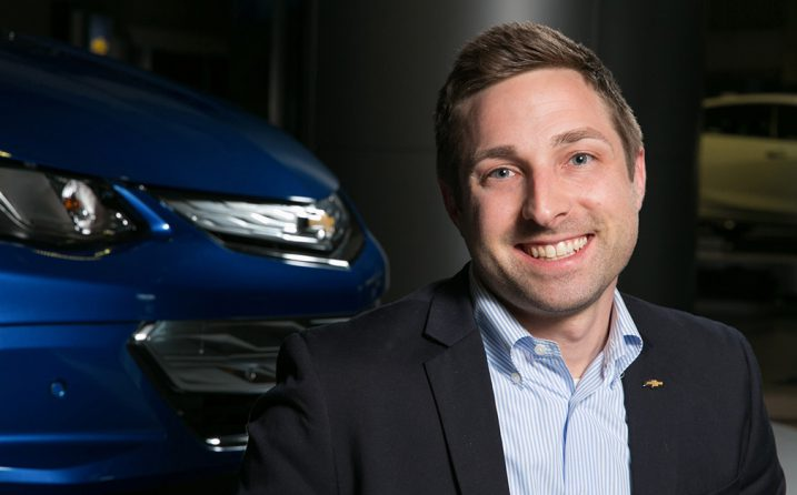 Cottrell MBA graduate Brad Wolf poses next to a Chevrolet vehicle
