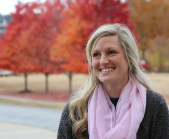 Sydney Pepin with fall trees in background