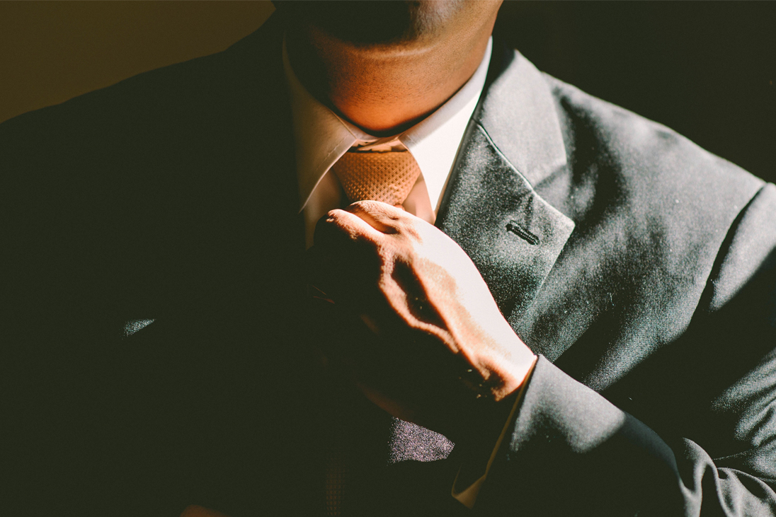 Man tying his tie - AACSB Accredited MBA article