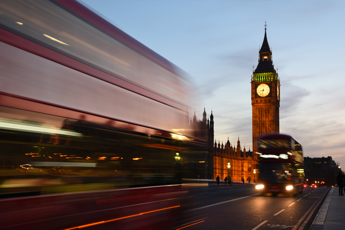 A bus passes Big Ben in London