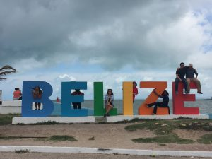 Students pose at the Belize City sign