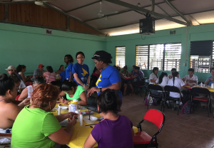 Enactus students teaching individuals in Belize City, Belize entrepreneurial skills