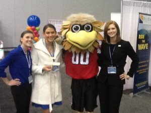 Cottrell Scholars pose for a photo with the Atlanta Falcons' Freddie Falcon