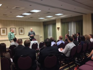 Cottrell MBA Students listen in during a private session for our students following the night's APICS meeting.
