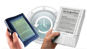 A small, dark-colored ereader and a larger, white-colored ereader, both displaying text on their screens.