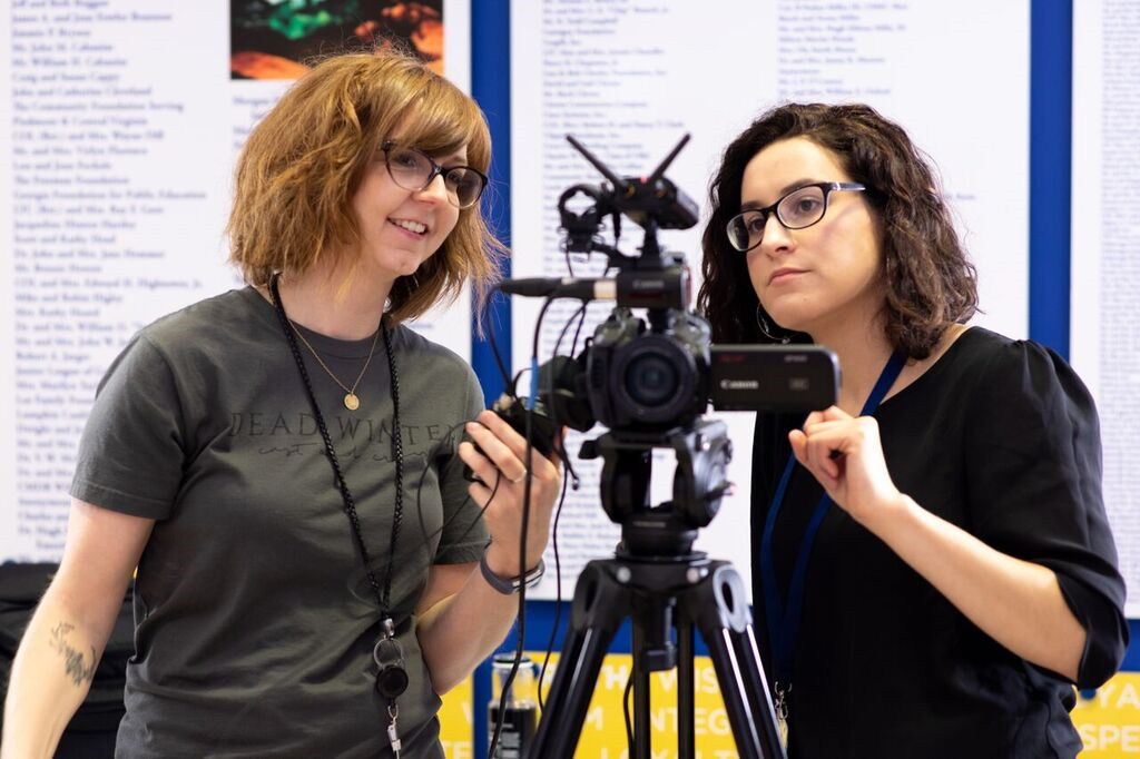 Professor Hogue and Student working with camera