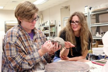 UNG senior Kati Hornick works on a sculpture of a turtle for the Faculty Undergraduate Summer Engagement project with Heather Foster, instructor of visual arts at UNG.