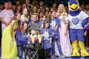 Make-A-Wish and athletes surprise family