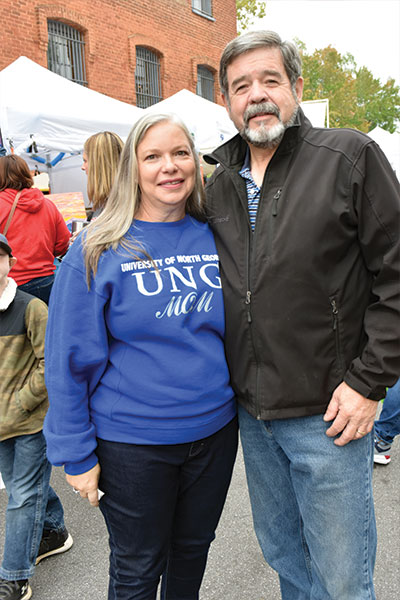 A couple, one wearing a ung shirt