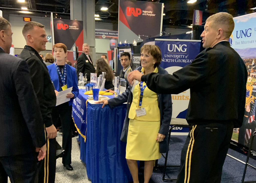 UNG President Dr. Bonita Jacobs and UNG Corps of Cadets students talk and laugh at the Association of the US Army's annual conference.