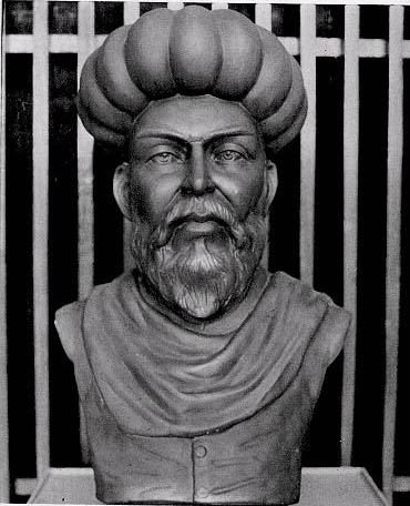 A statue of Ibn al-Nafis. He has a large beard and is wearing a turban.