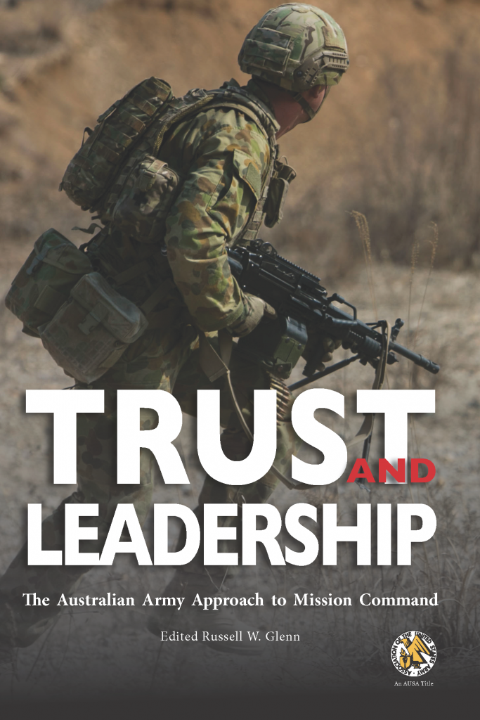 An Australian soldier is mid-run on the cover of Trust and Leadership (out Nov 2020 from the UNG Press)
